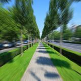Bicycling by the empty alley. Straight empty alley with motion blur effect Stock Photo