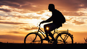 Bicycling in the evening Stock Photo