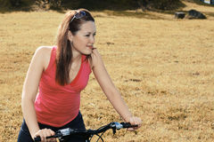 Bicycling in the field Stock Image
