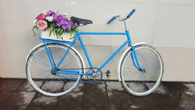 Bicycling with flowers Stock Image