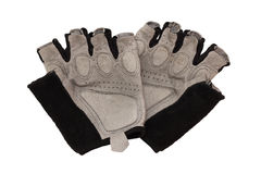 Bicycling gloves. Bicycle gloves it is black - silvery color isolated on a white background royalty free stock images