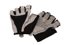 Bicycling gloves. Bicycle gloves it is black - silvery color isolated on a white background Royalty Free Stock Photography