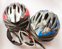 Bicycling helmets and glasses Stock Photos