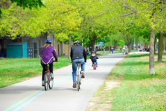 Bicycling in a park Stock Photography