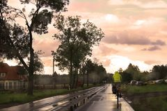 Bicycling after Rain Stock Image