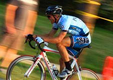Bicycling on roadway course Stock Images