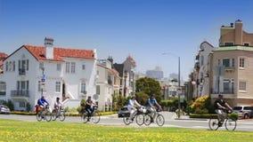 Bicycling San Francisco Through Marina District. Tourists and locals enjoy biking through the Marina District to the Golden Gate Bridge stock footage