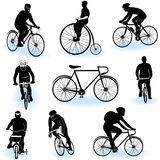 Bicycling silhouettes. A collection of 9 different bicycling silhouettes over white background Royalty Free Stock Photography