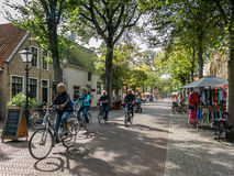 Bicycling tourists, Vlieland, Holland Royalty Free Stock Photos