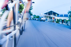 Bicycling in traffic. Low angle view of man bicycling in traffic stock image