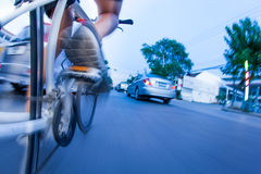 Bicycling in traffic. Man bicycling in traffic transportation Stock Images