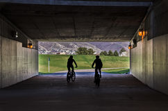 Bicycling Through a Tunnel Royalty Free Stock Images