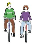 Bicycling. Two friends bicycling in their free time Royalty Free Stock Image