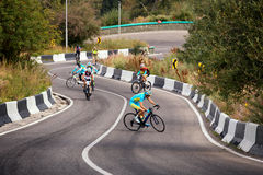 Bicycling uphill competition Stock Images