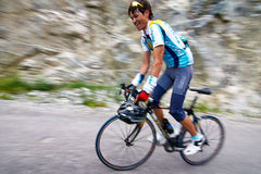 Bicycling uphill competition Royalty Free Stock Image