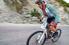 Bicycling uphill competition Royalty Free Stock Photo
