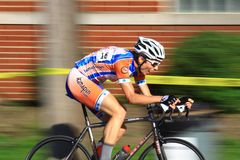 Bicycling on urban roadway. Pro cycling event on the paved roadway at the urban professional Criterium bicycle race in the city streets, USA Cycling event Royalty Free Stock Photos