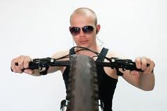 Bicyclist. Man in a dark studio ochkahv Royalty Free Stock Image