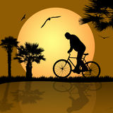 Bicyclist. On the abstract background Stock Photos