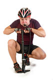 Bicyclist. Doping man with air pump Royalty Free Stock Photo
