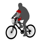 Bicyclist with baby in bicycle chair Stock Image