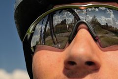 Bicyclist on a background of the sky royalty free stock photos
