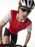 Bicyclist With Bicycle. Bicyclist riding bicycle against white background royalty free stock photos