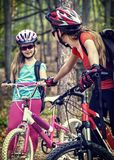 Bicyclist child ride on bicycle path in city. Children go down stairs in park. stock photos