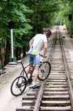 bicyclist climbing on the railroad Royalty Free Stock Images