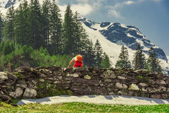 Bicyclist climbing Swiss Alps in spring Royalty Free Stock Photography