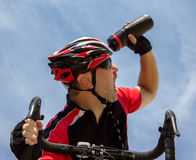 Bicyclist cools his head Stock Photography