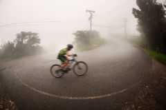 Bicyclist in the Costa Rican cloud forest Royalty Free Stock Photography