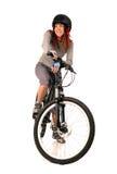 Bicyclist de la mujer aislado en blanco. Fotografía de archivo libre de regalías
