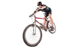 Bicyclist on a dirty bike. Male bicyclist riding a very dirty mountain bike downhill style Stock Photo