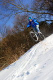 Bicyclist extreme snow Royalty Free Stock Photography