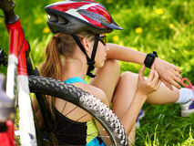 Bicyclist girl look on smart watch. Royalty Free Stock Photography