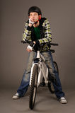 Bicyclist on gray. The bicyclist on gray background, studio shot Stock Photos