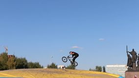 Bicyclist guy jumps into Big Air Bag during Aeromat jumps championship of Perm region stock video