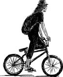 Bicyclist in a hat Royalty Free Stock Images