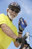 Bicyclist Holding Water Bottle Royalty Free Stock Image