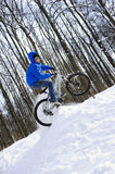Bicyclist jumping stock photo