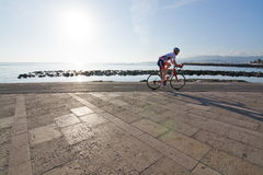 Bicyclist on the Molinar boardwalk Royalty Free Stock Photography