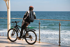 Bicyclist observes the view Royalty Free Stock Photography