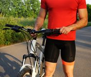 Bicyclist in the park. Closeup with bike royalty free stock photos