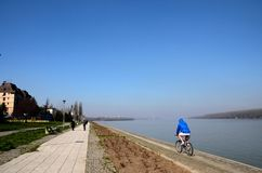Bicyclist and people at bank of Sava River Belgrade Serbia Royalty Free Stock Photo