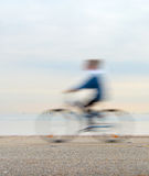 Bicyclist on a quay Royalty Free Stock Images