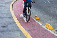 Bicyclist red bike path Royalty Free Stock Image