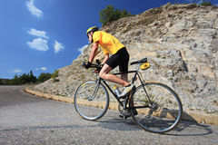 Bicyclist riding a bike. A view of a bicyclist riding a bike Royalty Free Stock Images