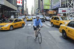 Bicyclist riding through midtown. A shot of a bicyclist riding through midtown manhattan Royalty Free Stock Photo