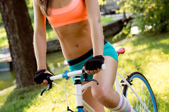 Bicyclist riding in park Stock Images